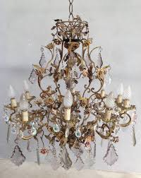 eleven lights chandelier with many porcelain flowers and nice basket on the top to be
