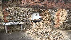Southgate Lane in Norwich strewn with rubble as hole is made through flint  wall | Eastern Daily Press