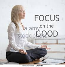 meditation office. business and healthy lifestyle concept portrait of young office woman sitting crosslegged in meditation