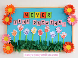 let your students help you with the most adorable and easy spring bulletin board have them st their hands on a piece of white construction paper use