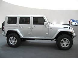 all silver 4 door color hard top jeep wrangler unlimited automatic technology package with bluetooth and black leather interior please