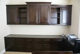 office built in. built in custom home office with upper and lower cabinetry, plenty of file drawers c