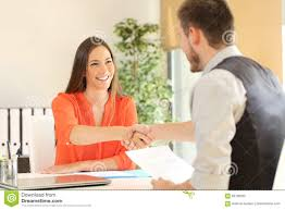 employee and boss handshaking after a job interview stock photo employee and boss handshaking after a job interview