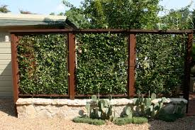 Vegetable Garden Fence Ideas | This garden had several seating areas.