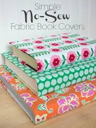 turn even the ugliest of books into colorful decorative accessories with this simple tutorial for no sew fabric book covers so pretty