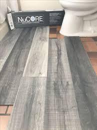 vinyl plank flooring thats waterproof lays right on top of your existing floor love