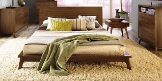 yellow textured carpet and low height wooden modern queen bed frame for stylish bedroom ideas