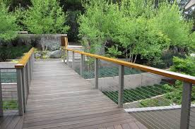 modern cable fence. Delighful Fence Modern Backyard Bridge With Cable Railings With Cable Fence T