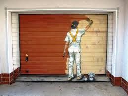 a painter in a white jumpsuit is painted in the middle of a half painted