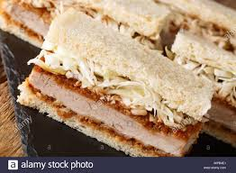 Japanese Katsu Sando sandwiches with tonkatsu sauce and cabbage close-up on  a slate board on the table. horizontal Stock Photo - Alamy