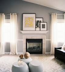 how to display artwork above fireplace with vaulted or cathedral ceiling.  Ideas for decor as