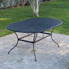 oval wrought iron patio dining table by woodard textured black com