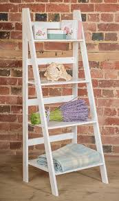 white ladder shelf with four tiers