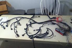 1991 corvette c4 ls swap racingjunk news Ls Wiring Harness Conversion rafael's wife let him take over the table in their exercise room while he worked on converting the wiring harness for the ls1 this harness came out of '99 ls wiring harness conversion in kansas