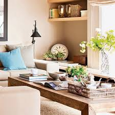 the living room is done in neutral beige tones with a rustic wooden coffee table