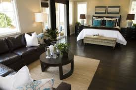 dark furniture decorating ideas. bedroom with dark brown hard flooring and furniture contrasting white doorway windows decorating ideas 1