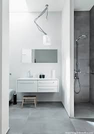 concrete bathrooms. personally, i think what makes this bathroom so beautiful is the natural light flowing from sky window and contrast of material: polished concrete bathrooms
