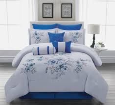 home design comforter. comforter with flower motifs in blue as the bedding a white round bedside table home design e