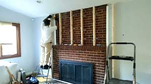 mount on brick mounting fireplace a over hang tv wall install hide