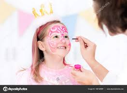 face painting for little girl princess and fairy theme birthday party with face paint artist and costume for preschool child kids celebrating or