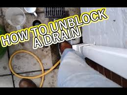 how to unblock a drain without spending money