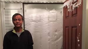 new jersey couple s front door is covered entirely with snow after blizzard