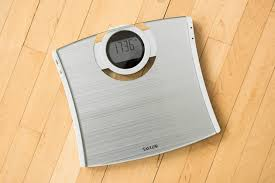 the silver taylor glass digital calmax scale on a wood floor the scale s edges are
