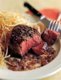 Place the tarragon branches around the beef, tying them in 4 or 5 places with kitchen string to keep them in place, and then brush the tarragon with the reserved oil. Recipes Filet Of Beef Au Poivre Food Network Recipes Beef Filet Recipes