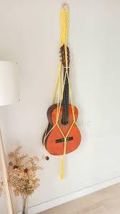 yellow macrame guitar wall hanger