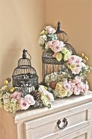 Silver birdcages for decor, add in candles in the center and small votives  around - could use as a centerpiece