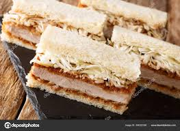Katsu Sando sandwiches with pork cutlet, tonkatsu sauce and cabb — Stock  Photo © lenyvavsha #304322350