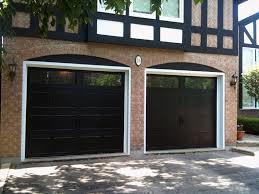 outdoor black paint costco garage doors with brick wall also