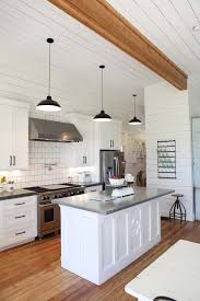 shiplap walls in white farmhouse kitchen of joannagaines