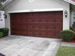 after the garage door is completely painted to look like wood i apply a uv clear coat on top to give the job a professional look and a very long lasting
