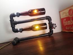 black iron furniture. Unique Diy Home Iron Pipe Furniture Idea Of Wall Lamp With Wine Bottles On Wooden Black