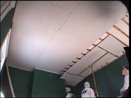 teamwork goes into installing drywall ceiling