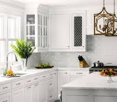 white kitchen with white glazed subway backsplash tiles view full size