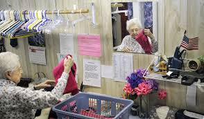 volunteer mary pinkham 93 folds clothing at the clothes closet thursday in gardiner