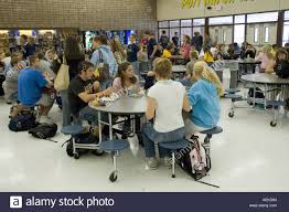 high school lunch table. High School Students Eat And Socialize Lunch In A Cafeteria Lunchroom - Stock Image Table E