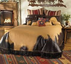 log cabin bedding with faux leather duvet cover alongside wood fireplace mantels and wrought iron screen
