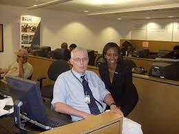 Washington Times Reporter Tom Ramstack and Akilah Owens at DC HOPE Center  after the U.S. Dept. of Commerce/EDA Partnership Announcement Ceremony -  John Hope Bryant