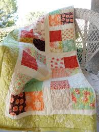 8 Lap Quilt Patterns for Cozy Lounging & Scrappy Four Patch Lap Quilt Adamdwight.com