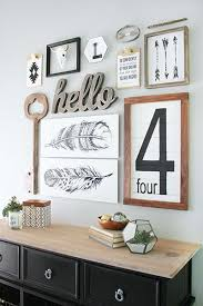 For an interesting look, try using some unique frames in your gallery wall,  like clipboards and reclaimed wood.