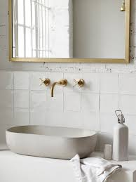 bert may have developed a new bathroom collection including a selection of made to order concrete basins paired with solid brass fixtures by sus based