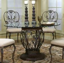 kitchen pedestal dining table set: appealing silver color inspiring dark brown color wrought iron kitchen table set round shape floral pattern metal art pedestal table round shape glass table top candlesticks holders floral pattern brown plush rug wrought i
