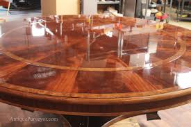 extra large mahogany table with banding and perimeter leaves expands to seat 10 12 people