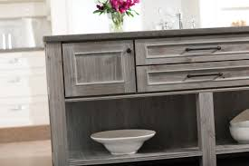 weathered gray kitchen cabinetry finishes both painted and sned gain pority