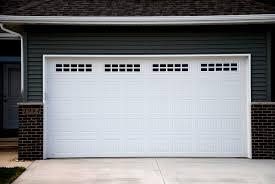 modern white garage door exterior modern white garage door with small windows accent