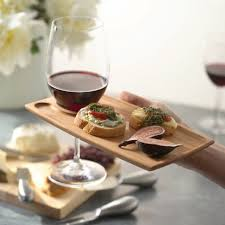 the wine and dine appetizer plate wine glass holder is a convenient attractive solution for simultaneously carrying a wine glass and sampling hors