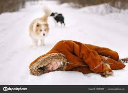the young girl in a fur coat child lying in the snow and her dog suit